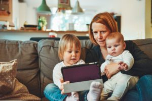woman doing online hypnobirthing course at home